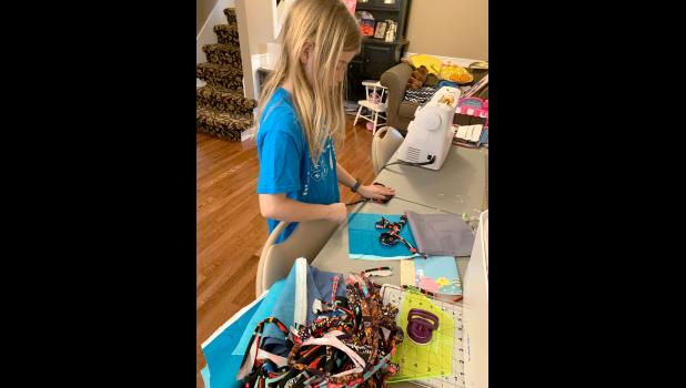 """Olivia Buller, 9, member of Cameron Keystones Willing Works 4-H Club, says she got involved because """"I enjoy doing something to help others that are helping keep us safe."""""""