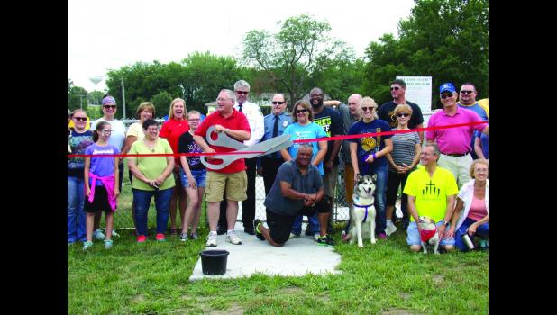 Dr. Carr cutting the ribbon at the grand opening of the Dog Park, located next to Beaver Park.