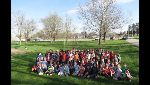 The Kindergarten class of 2030 with their tree, donated by The Tree Patch.
