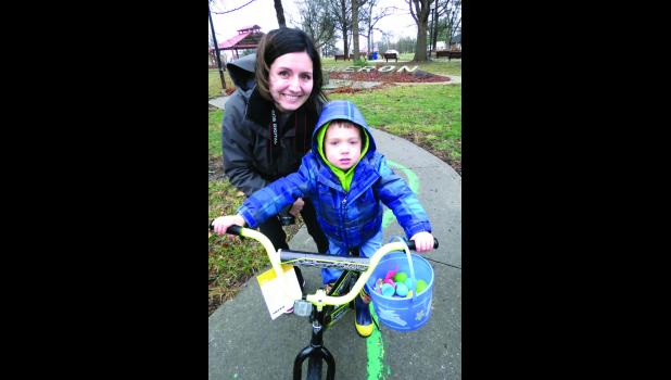 Brecken Tuttle winner of the boys bike with Amanda Tuttle.