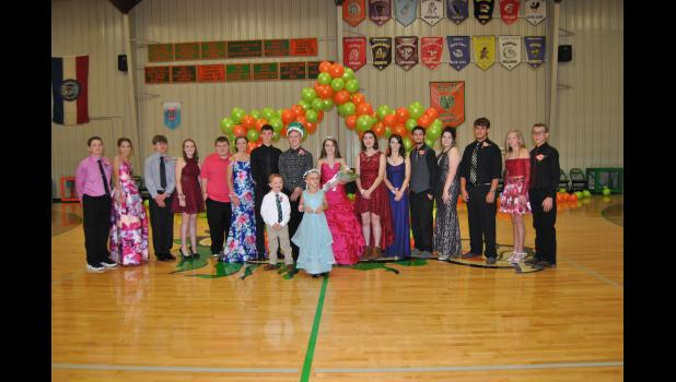 Photo:  2018 Osborn Carnival Royalty and attendants Back row: 7th Graders Ethan Hall and Josie Brush, Freshman Quentin Hughes and Mackenzie Perry, Juniors William Powers and Brionna Frans, Student Council Escort Denny Hankins, Carnival King Michael Rueckert and Queen Madi Gray,  Returning Royalty Karena Cascioli, Seniors Stephanie White and Brayden Grimshaw, Sophomores Gwen DeKam and John Bell, and 8th Graders Tommie Jo Gregg and Braxton Gibson  Front row: Gift Bearer Boston Brady, Flower Girl Olivia Owens