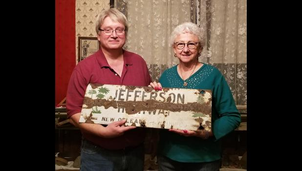 Stan Hendrix and Charnett Norton display a rare original Jefferson Highway signs.