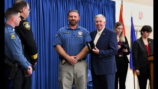 Corrections officer Andrew W. Fritzinger receives the Governor's Award for his role in the 2018 prison riot.