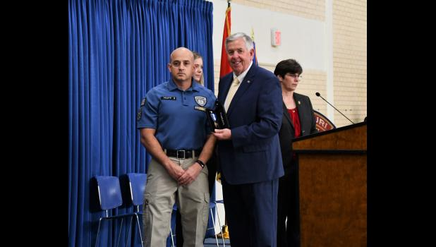 Corrections officer Jason M. Huff receives the Governor's Award for his role in the 2018 prison riot.
