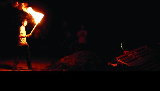 Cameron seniors light the annual bonfire the night before homecoming.