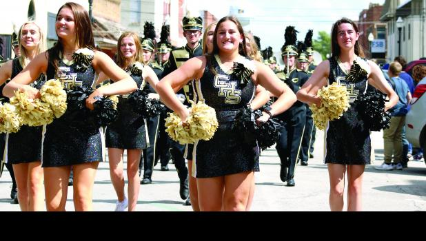 The Cameron Pom Squad leads the parade through downtown Friday.