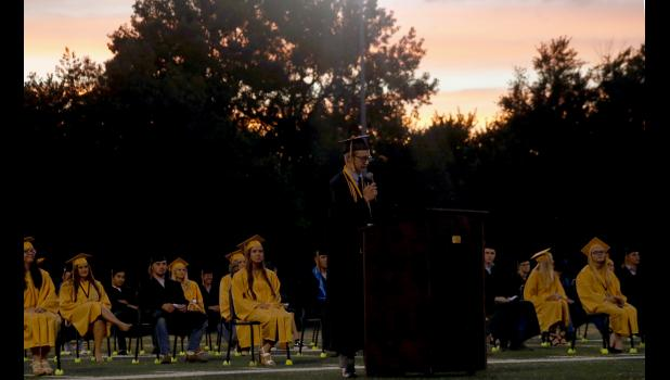 Spencer Ice speaks to his fellow seniors Friday evening.