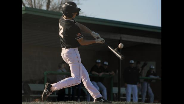 Cameron High School sophomore shortstop Graden Hammon drives in a run during the second inning of Monday's season opener.