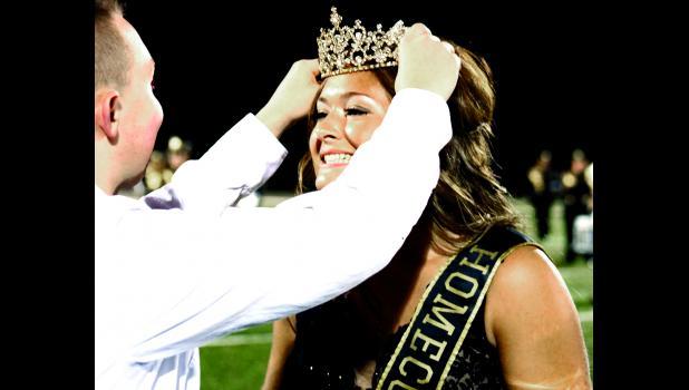 Colton Pickeral, 2018 homecoming king, crowns 2019 homecoming queen Alisha Neal.