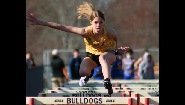 Claire Wenck leaps while doing the hurdles last Thursday in Odessa.