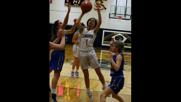Junior guard Mica Dunscombe goes up for a shot.