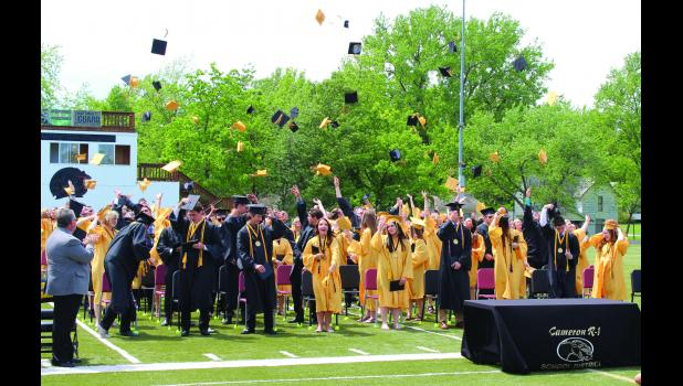 Cameron High School graduates celebrate by throwing their caps in the air. Graduation was held on Dave Goodwin Field on Sunday, May 22.