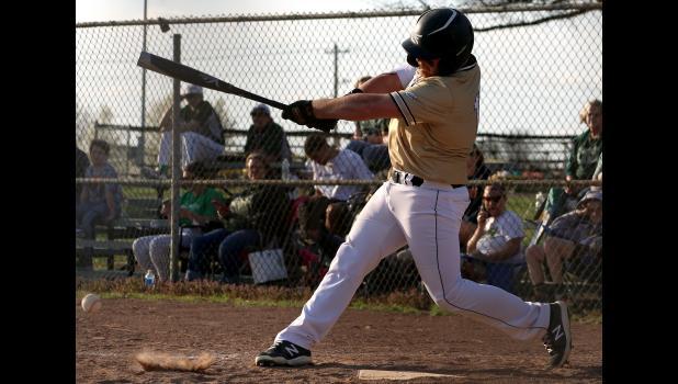 Cameron senior catcher Wyatt Burnett drives in the Dragons' first run in three games Monday against Lafayette.