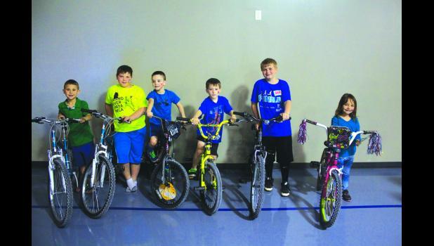 Six bicycles were raffled off during the Cameron Regional YMCA Healthy Kids Day on Saturday.  L to R:  Noah Buller, Tyler Minard, Bradley Walker, Jaxson Ramsey, Logan Malott, Stormy Byers
