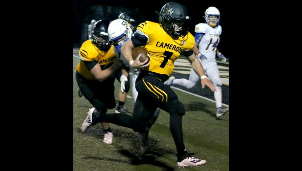 Cameron senior quarterback Ty Campbell rushes for a touchdown last Friday.