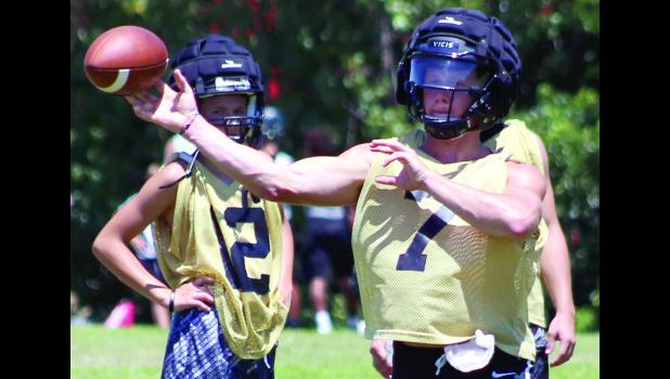 Cameron High School quarterback Ty Campbell hits a receiver during the 7-on-7 game against Richmond last Saturday.