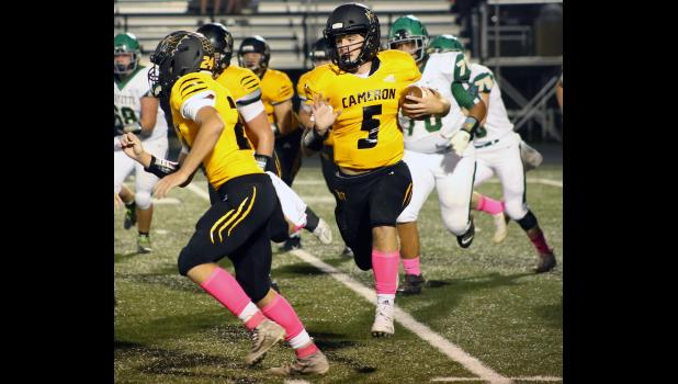 Ty Speer gets up field on a double-digit run Friday night.