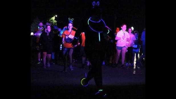 Great Pumpkin Glow Run participant Taeloree Teel gets ahead of the pack Saturday night.