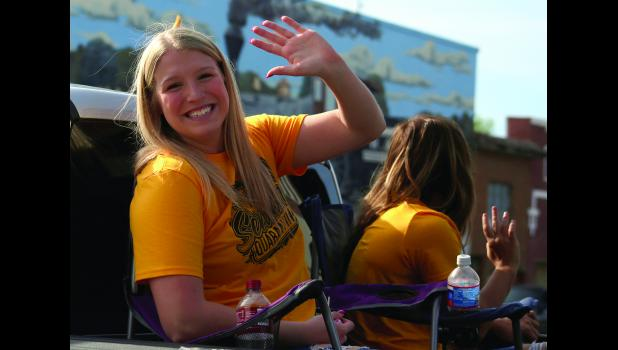 Brenna Bontrager waves to the camera Friday afternoon in downtown Cameron.