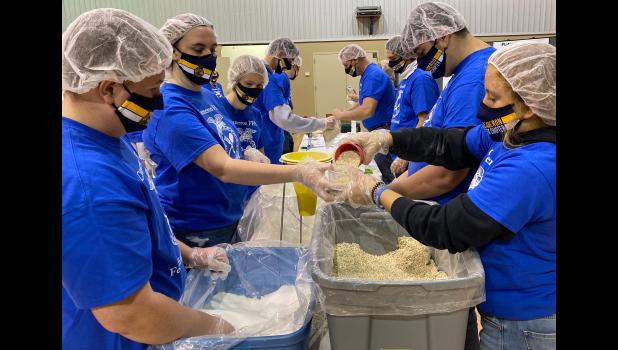 Cameron High School FFA students and volunteer prepare more than 50,000 meals last Thursday and Friday.