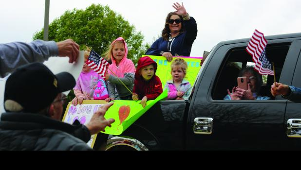 Addy and Aubree Sloan, Kane, Heather, Kashlynn and Shirley Hayes wave to Gene Hayes Tuesday.