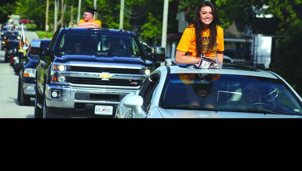 Cameron High School senior Jade Wilson rides in front of a pack of cars for a parade Friday afternoon.