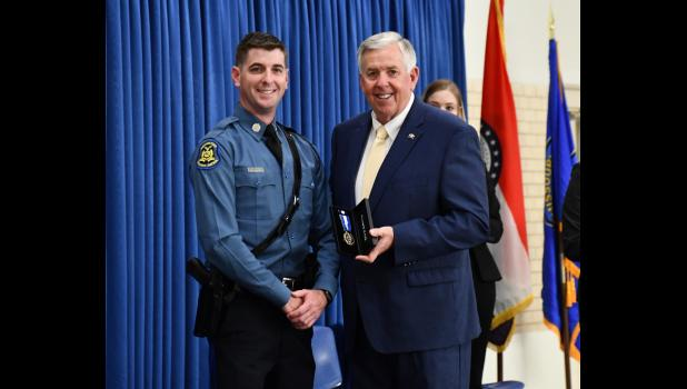 Bradley R. Muck with Missouri Highway Patrol Troop H receives the Governor's Award for his role in the 2018 prison riot.