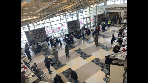 Hundreds fill the Cameron High School cafeteria during a mass vaccination event last February.
