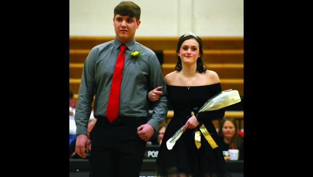 Seth Dunscombe escorts fellow senior candidate Madison Thogmartin before her crowning.
