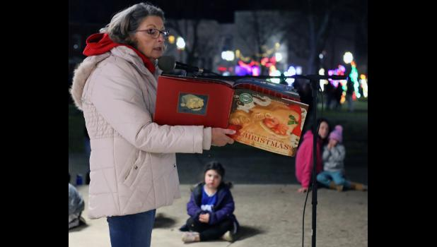 Cameron City Councilwoman Darlene Breckenridge reads to area kids during Christmas in Cameron early this month.
