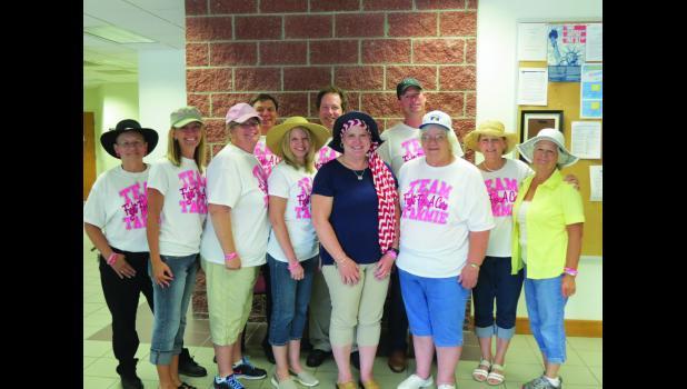City employees show their support with the Team Tammie shirts and their hats. Mark Gaugh, Tim Hamilton, Drew Bontrager, Rae Flinn, Amy McVicker, Carmen Weigand, Pam Korneman, Tammie Schmitz, Glenda Atkinson, Barbara O'Connor, Dixe, and Dixie Masters.