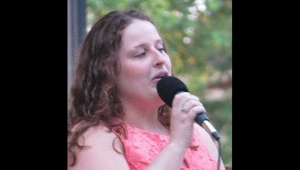 Vocalist Staci Harvey performs They Can't Take that Away From Me