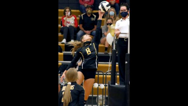 Cameron junior outside hitter Avery McVicker goes up for a spike.