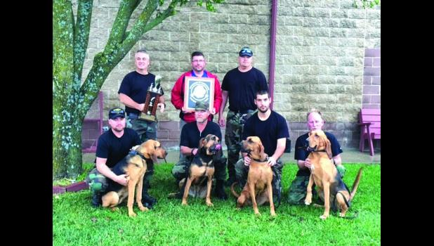 Back Row: Bryan Williams, Team Leader, Danny Engel, Brian Youtsey  Front Row: Tyeson Claypool, Team Leader, Dennis Hudlemeyer, Zach Bendure, Michael Snoderly  Dogs: Bob, Aurora, Molly, Dale Ann