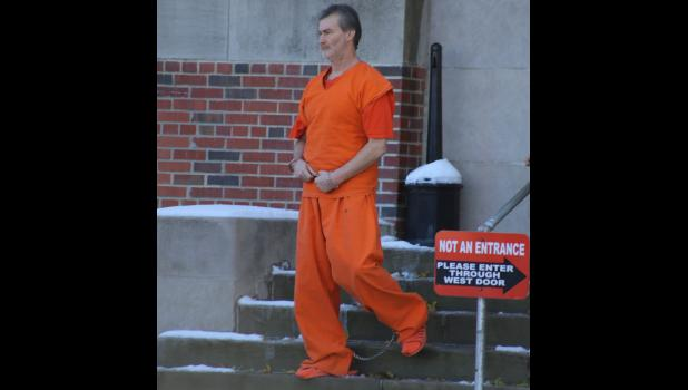Kenneth Wykert walks out of court after recently appointed Judge Roger Prokes approved moving his trial to Nodaway County.