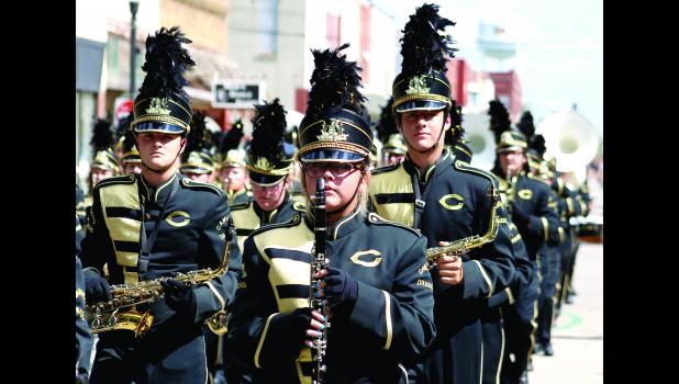 The Cameron Marching Dragons stroll through downtown Friday afternoon.