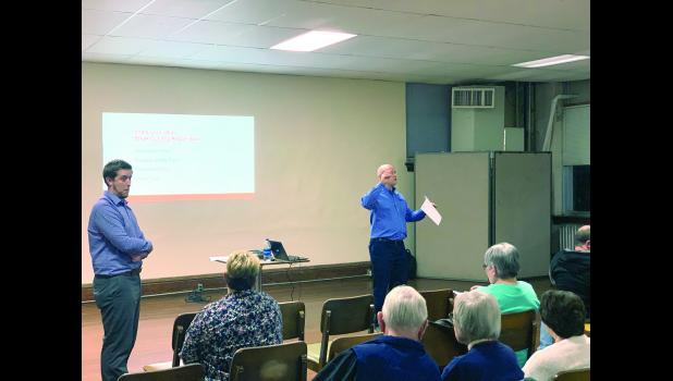 Ben White and speaker Keith Winge speak to local citizens and business owners