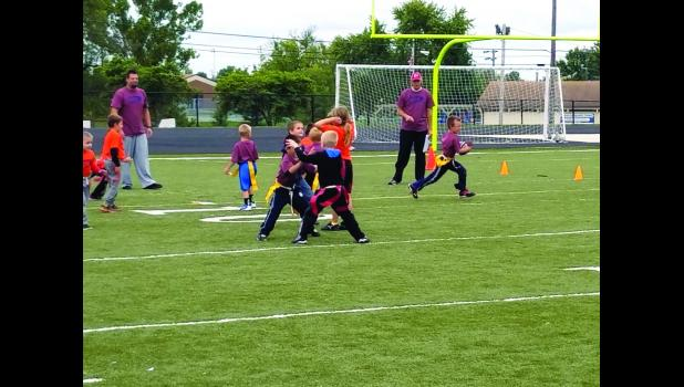 Children have the opportunity to play sports, such as flag football and basketball.