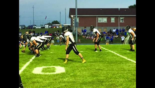 The Cameron Dragons offense lines up against the Higginsville Huskers during the first game of the season.