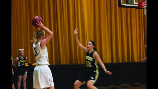 Cameron's Hannah Robinson searches for an opportunity during the Lady Dragons' 34-24 win over Excelsior Springs