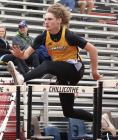 Sophomore James Jefferson clears a hurdle at last Saturday's district meet.
