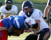 Sophomore linebacker Kaydan Brown stops a Southeast Kansas City running back in his tracks Friday night.
