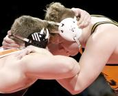 Cameron senior Cam Hedgpeth ties up with Oak Grove's Caleb Groff in the Missouri heavyweight title match Thursday night.