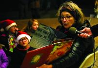 Cameron Mayor Darlene Breckenridge reads 'Twas the Night Before Christmas' to kids Saturday night.
