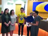 Students involved in DRGN network stand as a proclamation honoring them is read by Mayor Darlene Breckenridge.