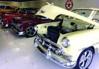 Vintage cars fill the formerly empty showroom of the repurposed Sears building
