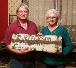 Stan Hendrix and Charnett Norton display a rare original Jefferson Highway signs.