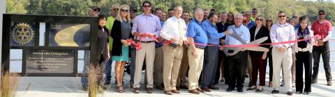 Members of the Cameron Rotary Club, City of Cameron, Cameron Area Chamber of Commerce and others cut the ribbon on the new, ADA compliant Sunrise Lake Fishing Dock Monday afternoon. Cameron Public Works Director Drew Bontrager described the project as the centerpiece of Sunrise Lake.