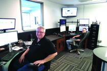 Stan Hendrix and Taylor Knott in the Dispatch Center at the Cameron Police Department.