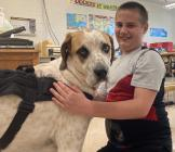 Dalton Stufflebean poses for a photo with Cameron R-1 School District's newest staff member Odie.